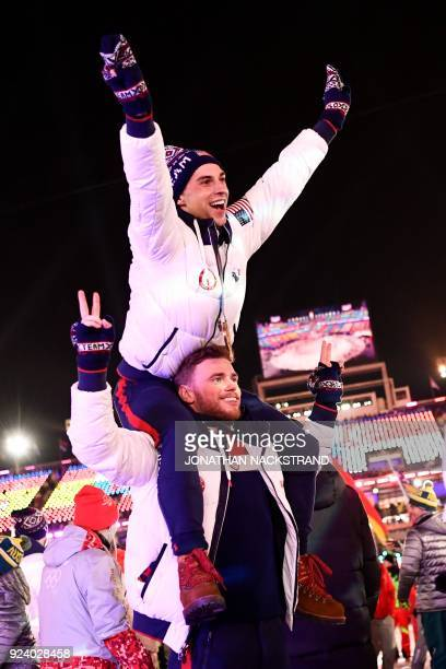 Athletes Adam Rippon and Gus Kenworthy parade with other delegations during the closing ceremony of the Pyeongchang 2018 Winter Olympic Games at the...