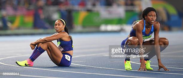 US athletes Allyson Felix left and Phyllis Francis watch the replay of the finish of their 400meter final on Monday Aug 15 2016 at the Rio Olympic...