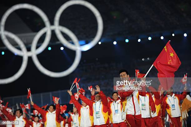 Athletes and members of China's delegation including flag bearer and acrobatic skier Han Xiaopeng attend the opening ceremony for the Vancouver...