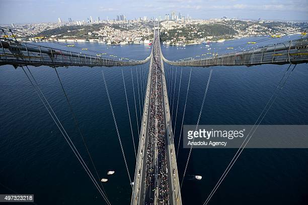 Athletes and members of the public take part in 37th Vodafone Istanbul Marathon one of the top 10 marathons in the world on the Bosphorus Bridge in...