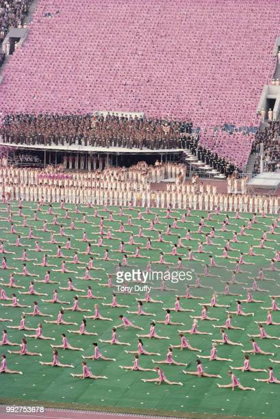Athletes and musicians perform during the Opening Ceremony event for the XXII Olympic Summer Games on 19 July 1980 at the Grand Arena of the Central...
