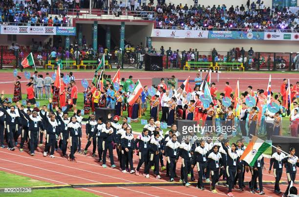 Athletes and officials with the Indian team take part in the opening ceremony of the 22nd Asian Athletics Championships at Kalinga Stadium in...
