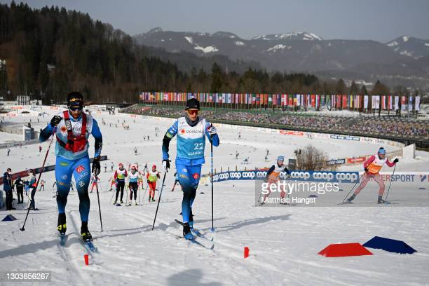 Athletes and team members in action during a cross country training session ahead of the FIS Nordic World Ski Championships 2021 in Oberstdorf on...
