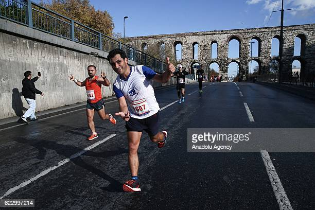 Athletes and thousands of people take part in the 38th Vodafone Istanbul Marathon the worlds only road race where people can run from Asia to Europe...