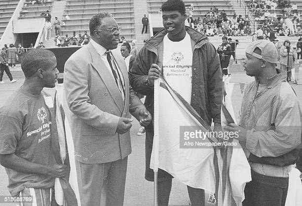 Athletes and two men during the Special Olympics Maryland 1995