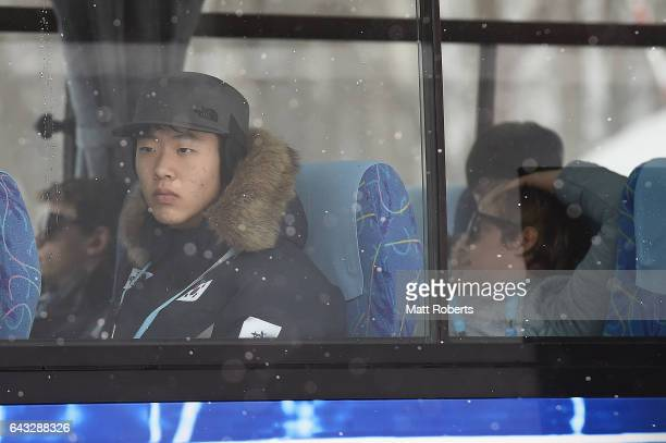 Athletes are seen leaving after competition was cancelled for the day due to bad weather in Ski Jumping Men's Normal Hill Individual on day four of...