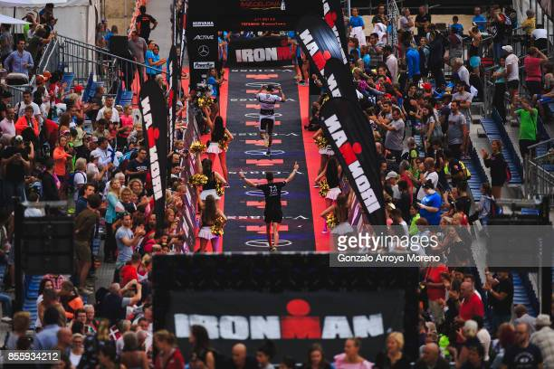 Athletes arrive to the finish line of the IRONMAN Barcelona on September 30 2017 in Calella Barcelona province Spain
