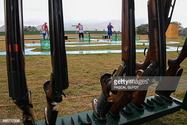 Athletes attend a training session for the double trap shooting event at the Olympic Shooting Centre in Rio de Janeiro on August 3 ahead of the Rio...
