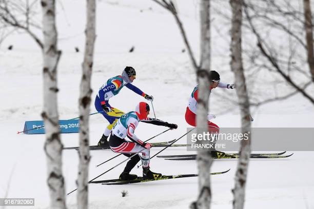 Athletes Austria's Max Hauke Japan's Keishin Yoshida and Andorra's Irineu Esteve Altimiras compete in the men's 15km 15km crosscountry skiathlon at...