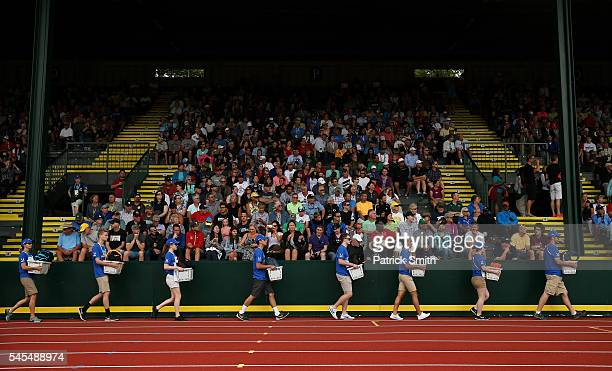 Athletes belongings are moved in baskets as fans look on during the 2016 U.S. Olympic Track & Field Team Trials at Hayward Field on July 7, 2016 in...