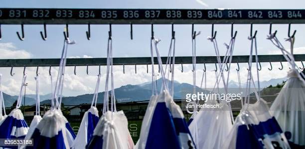 Athletes blue bags hang at the transition area ahead of tomorrow's IRONMAN 703 Zell am SeeKaprun triathlon event on August July 26 2017 in Zell am...