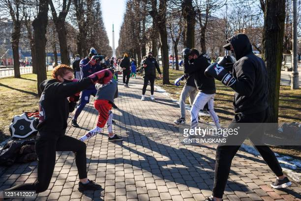 Athletes, boxers and fitness trainers take part in an open air training as a form of protest against coronavirus restrictions to remind the...