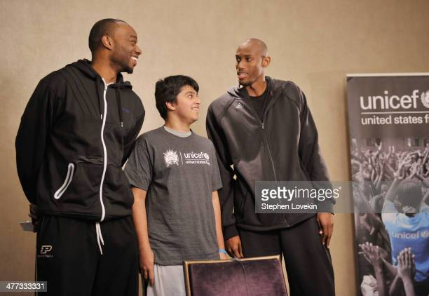 NBA athletes Carl Landry and Travis Outlaw record a PSA with a student from The United Nations International School at an event recognizing New York...