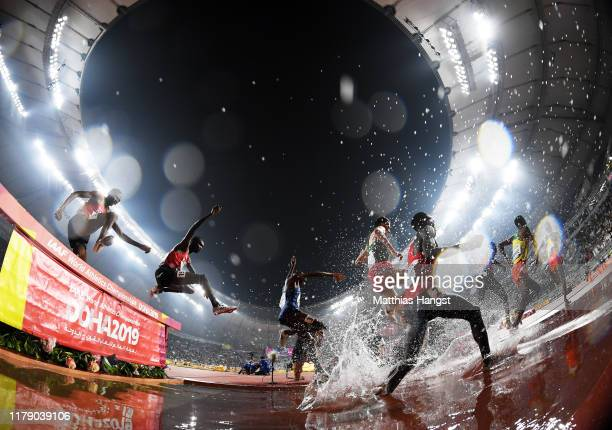 Athletes clear the water jump as they compete in the Men's 3000 metres Steeplechase final during day eight of 17th IAAF World Athletics Championships...