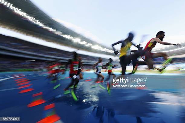 Athletes clear the water jump as they compete in the Men's 3000 metres Steeplechase heats on Day 10 of the Rio 2016 Olympic Games at the Olympic...
