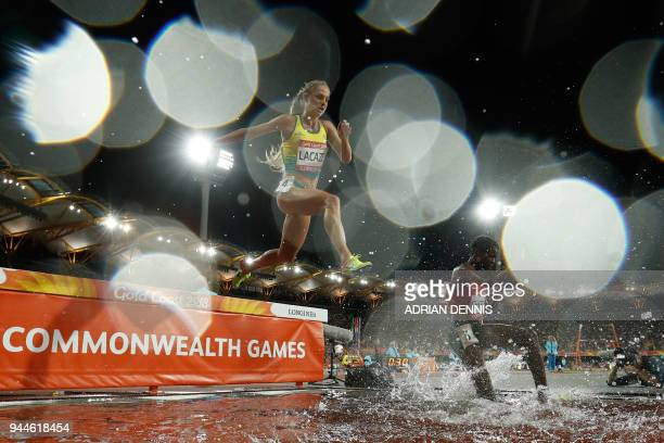 Athletes clear the water jump in the athletics women's 3000m steeplechase final during the 2018 Gold Coast Commonwealth Games at the Carrara Stadium...