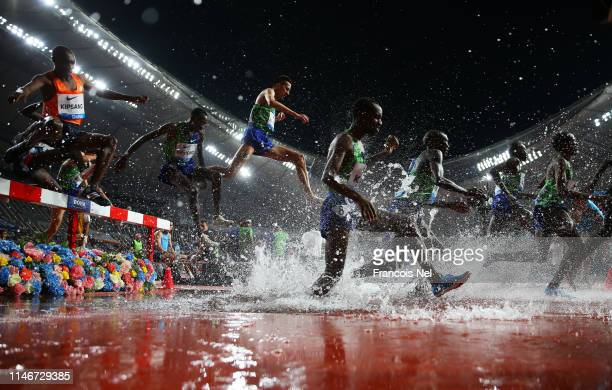 Athletes clear the water jump in the Men's 3000 metres Steeplechase during the IAAF Diamond League event at the Khalifa International Stadium on May...