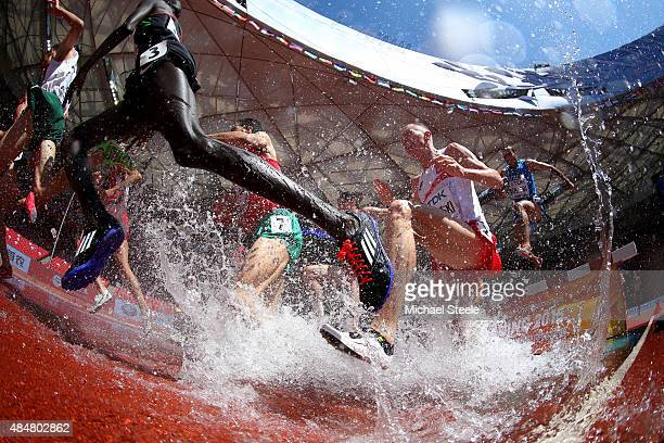 Athletes clear the water jump in the Men's 3000 metres steeplechase heats during day one of the 15th IAAF World Athletics Championships Beijing 2015...