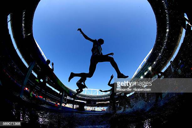 Athletes clear the water jump in the Women's 3000m Steeplechase Round 1 on Day 8 of the Rio 2016 Olympic Games at the Olympic Stadium on August 13,...