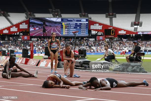TOPSHOT Athletes collapse after finishing the Women's 1 mile event during the anniversary games at the Queen Elizabeth stadium in London on July 22...