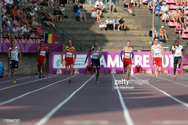 Athletes come round the bend in the final of the Men's 200m with eventual winner Karol Zalewski second from right during day three of The European...