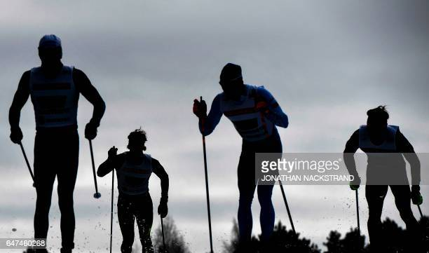 Athletes compete at the Men 4 x 10 km Relay event of the 2017 FIS Nordic World Ski Championships in Lahti, Finland, on March 3, 2017. / AFP PHOTO /...
