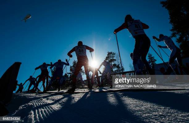 Athletes compete at the men 50 km Mass Start Free event of the 2017 FIS Nordic World Ski Championships in Lahti Finland on March 5 2017 / AFP PHOTO /...