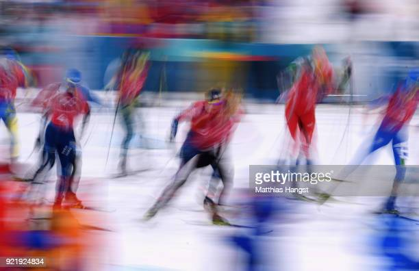 Athletes compete at the race start during the Cross Country Men's Team Sprint Free semi final on day 12 of the PyeongChang 2018 Winter Olympic Games...