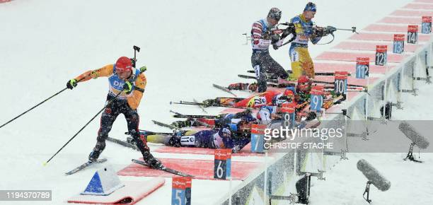 Athletes compete at the shooting range during the men's 4x75km relay event of the IBU Biathlon World Cup in Ruhpolding southern Germany on January 18...