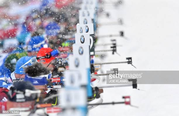 Athletes compete at the shooting stand in the men's 125 km pursuit event at the IBU World Cup Biathlon in Hochfilzen Austria on December 9 2017 / AFP...