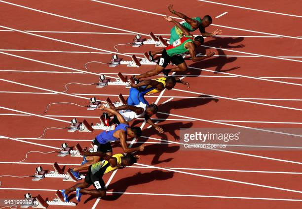Athletes compete at the start in the Men's 100 metres heats on day four of the Gold Coast 2018 Commonwealth Games at Carrara Stadium on April 8 2018...