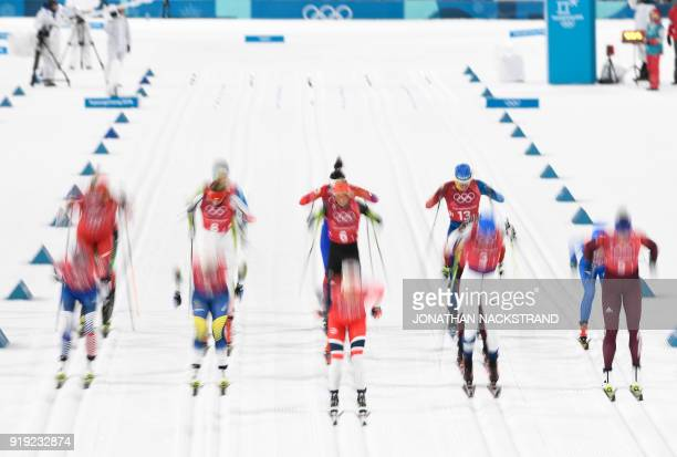 TOPSHOT Athletes compete at the start of the women's 4x5km classic free style cross country relay at the Alpensia cross country ski centre during the...