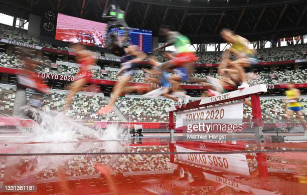 Athletes compete during round one of the Men's 3000m Steeplechase heats on day seven of the Tokyo 2020 Olympic Games at Olympic Stadium on July 30,...