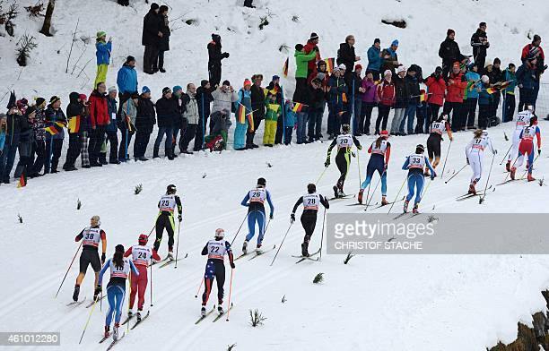 Athletes compete during the 10 kilometers pursuit classic style women's competition of the Tour de Ski Cross Country World Cup on January 4 2015 in...