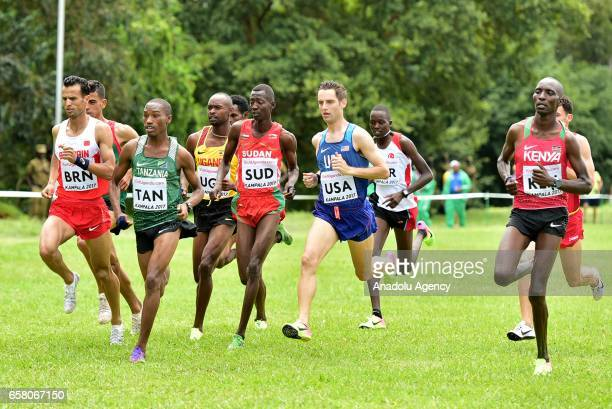 Athletes compete during the 27th World Cross Country Championships organized by International Association of Athletics Federations at Kololo SSS...