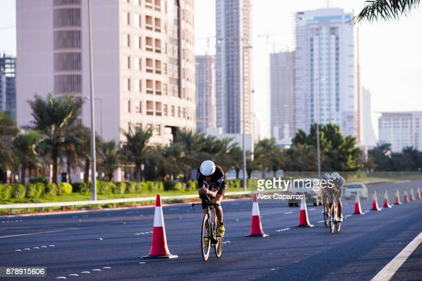 Athletes compete during the bike leg of IRONMAN 703 Middle East Championship Bahrain on November 25 2017 in Bahrain Bahrain