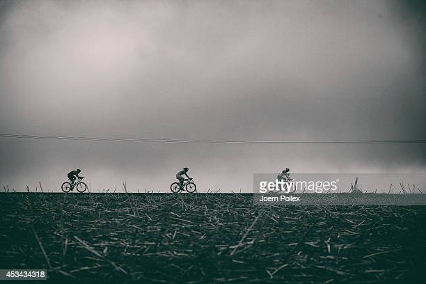 Athletes compete during the cycling leg of the Ironman 703 European Championship on August 10 2014 in Wiesbaden Germany