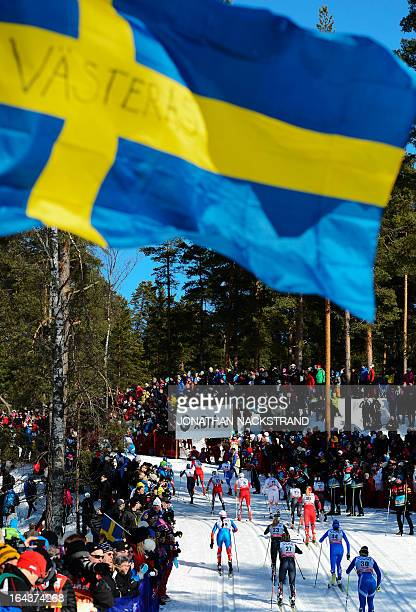 Athletes compete during the FIS CrossCountry World Cup Ladies 10 km Classic Mass Start in Falun Sweden on March 23 2013 Norway's Marit Bjoergen won...