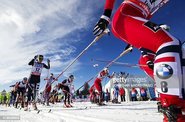 Athletes compete during the FIS CrossCountry World Cup Ladies Skiathlon 75 classic and 75 km free competition in Falun Sweden on March 15 2014...