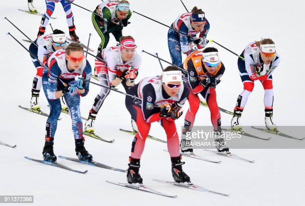 Athletes compete during the Ladies FIS Cross Country 10 km Mass Start World Cup on January 28, 2018 in Seefeld, Austria. / AFP PHOTO / APA / BARBARA...