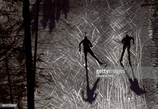 TOPSHOT Athletes compete during the Men's 10 km Sprint race during the 2017 IBU World Championships Biathlon in Hochfilzen on February 11 2017 / AFP...