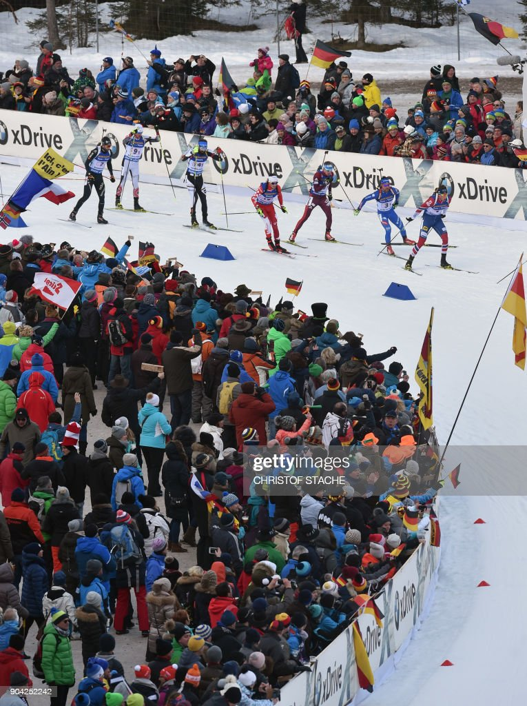Athletes compete during the men's 4 x 7,5km relay event at the Biathlon World Cup on January 12, 2018 in Ruhpolding, southern Germany. /