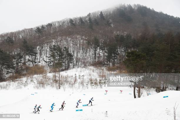 Athletes compete during the men's 50km cross country mass start classic at the Alpensia cross country ski centre during the Pyeongchang 2018 Winter...