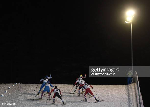 TOPSHOT Athletes compete during the men's crosscountry 16 km sprint competition at the FIS Nordic Ski World Championship in Lahti on February 23 2017...