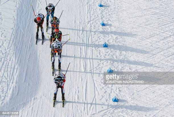 TOPSHOT Athletes compete during the men's nordic combined 10 km individual Gundersen event of the 2017 FIS Nordic World Ski Championships in Lahti...