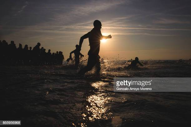 Athletes compete during the rolling start of the swimming course of the IRONMAN Barcelona on September 30 2017 in Calella Barcelona province Spain