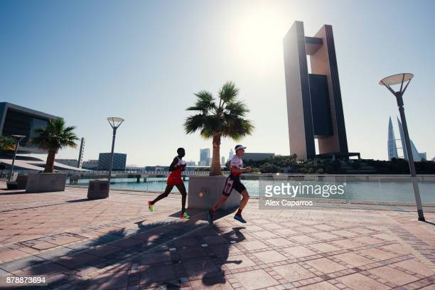 Athletes compete during the run leg of IRONMAN 703 Middle East Championship Bahrain on November 25 2017 in Bahrain Bahrain