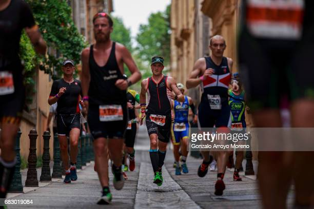 Athletes compete during the running course of the Ironman 703 Pays d'Aix on May 14 2017 in AixenProvence France