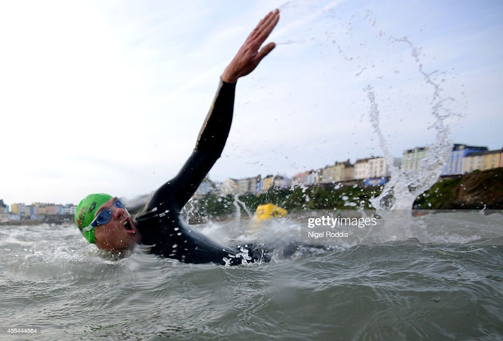 Athletes compete during the swim section of Ironman Wales on September 14, 2014 in Pembroke, Wales.