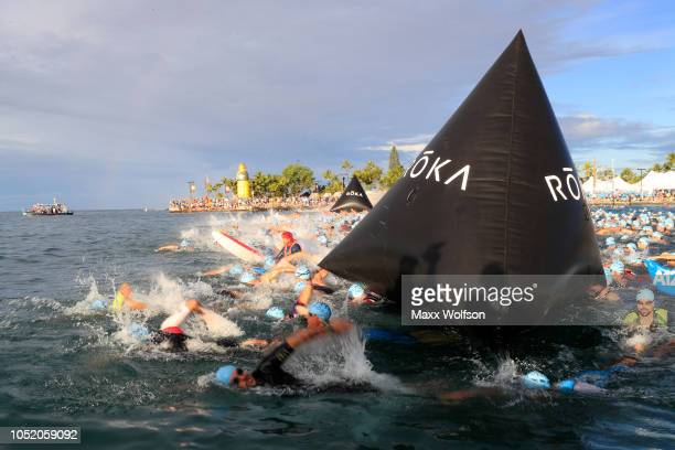 Athletes compete during the swimming course of the IRONMAN World Championships brought to you by Amazon on October 13 2018 in Kailua Kona Hawaii